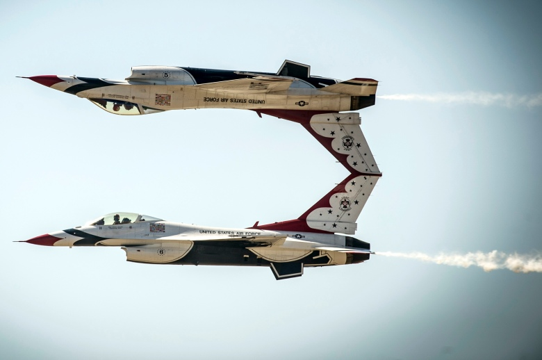 U.S. Air Force pilots with the Thunderbirds perform the calypso pass maneuver at Mountain Home Air Force Base, Idaho