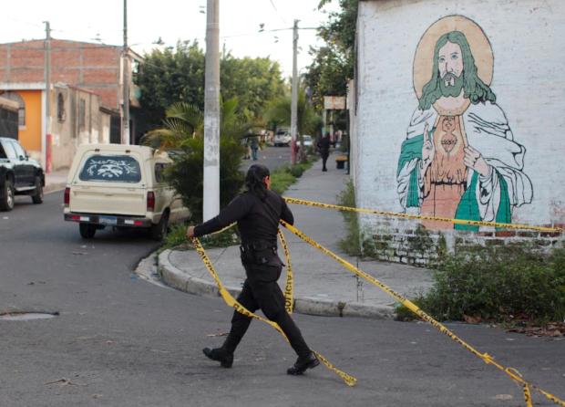 Removing crime tape San Salvador